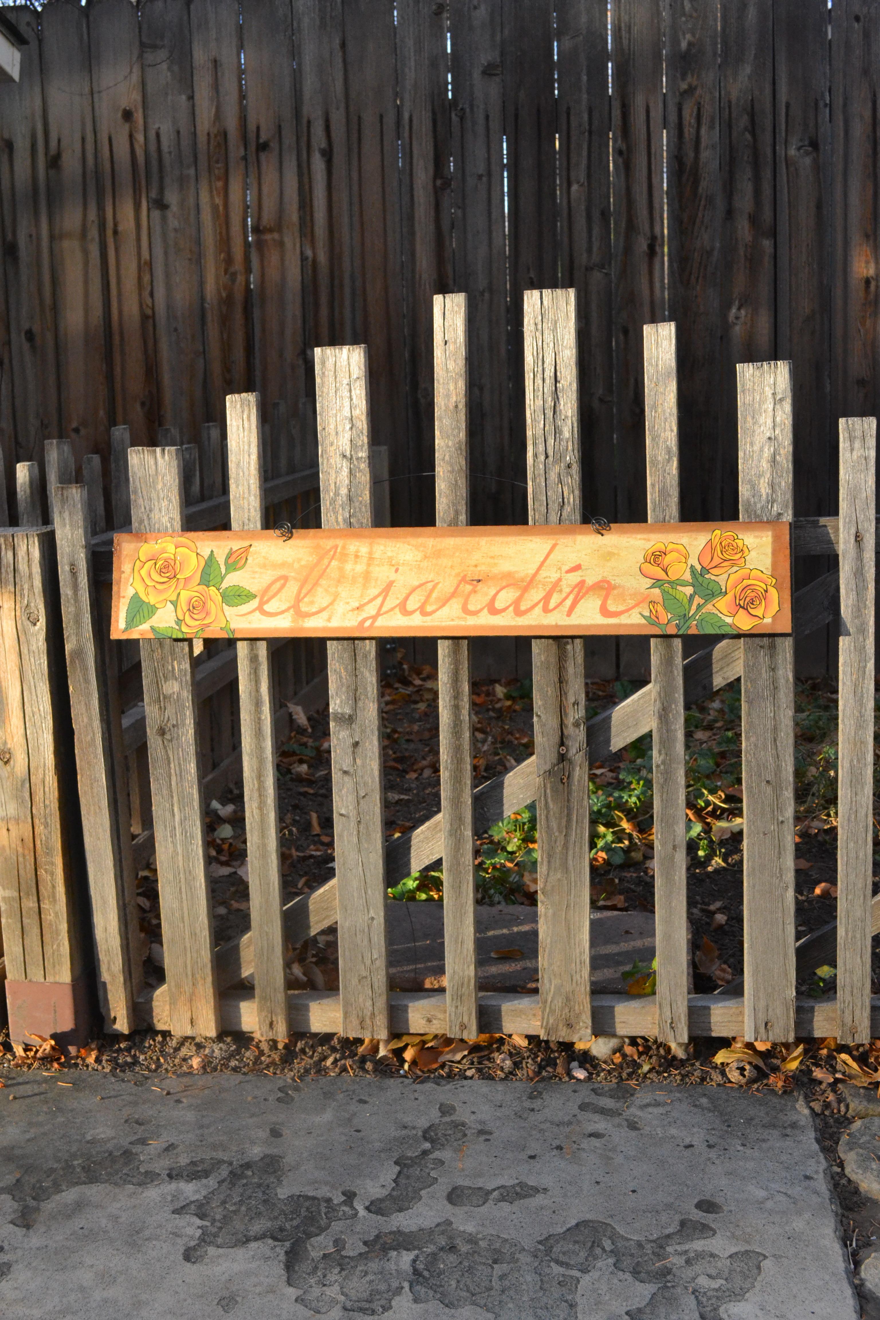 El jardín sign